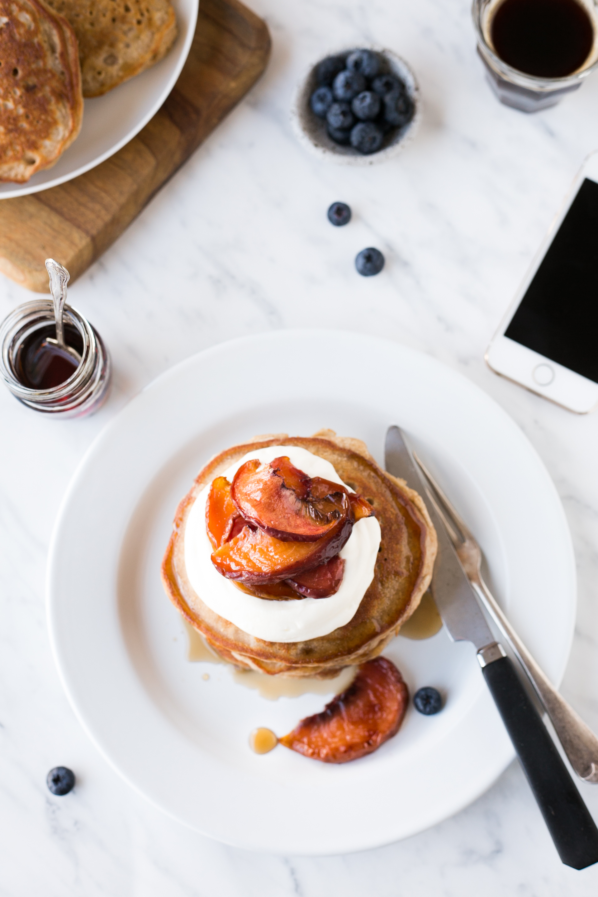 Buckwheat pancakes with baked peaches and vanilla bean yogurt || The Luminous Kitchen